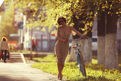 Girl on bike sunset Stock Image