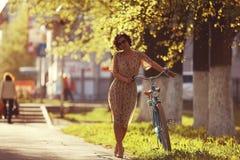 Girl on bike sunset Stock Image