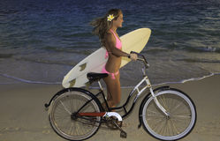 Girl with bike and surfboard Royalty Free Stock Photography