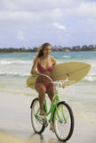 Girl with bike and surfboard Royalty Free Stock Photos