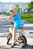 Girl on bike, turning back, looking at camera Stock Images