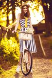 Girl on a bike in the village Royalty Free Stock Photos