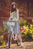 Girl on a bike in the village Stock Photography