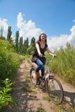 Girl on the bike Stock Image