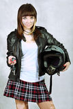 Girl Biker. The girl in a leather jacket with a helmet royalty free stock photography