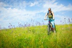 Girl biking Stock Image