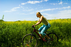 Girl biking Royalty Free Stock Image