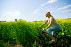Girl biking Royalty Free Stock Photos