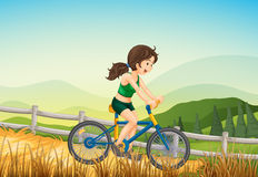 A girl biking at the farm. Illustration of a girl biking at the farm Royalty Free Stock Photos