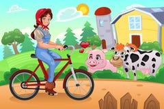 Girl Biking in a Farm Royalty Free Stock Image