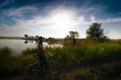 Girl biking at sunrise Royalty Free Stock Photos
