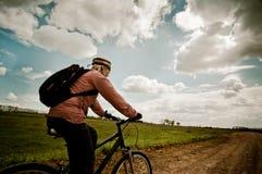 Girl biking at sunrise Royalty Free Stock Photo