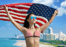 Girl in bikini with the American flag Royalty Free Stock Photo