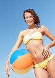 Girl in bikini with ball on the beach Royalty Free Stock Images