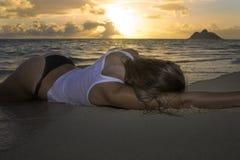 Girl in bikini at the beach. Beautiful blond girl in bikini at the beach royalty free stock photography