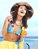 Girl in bikini on beach drinking cocktail. Stock Photography