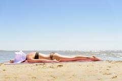 Girl in bikini on a beach Stock Image