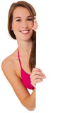 Girl in bikini behind white wall Stock Photo