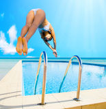 Girl in bikini diving Stock Photography