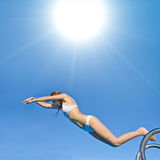 Girl bikini diving into water Stock Photography