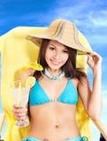 Girl in bikini drinking cocktail. Stock Photo