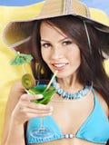Girl in bikini drinking cocktail. Stock Photos