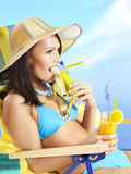 Girl in bikini drinking cocktail. Royalty Free Stock Photography