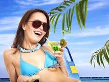 Girl in bikini drinking cocktail. Stock Image