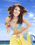 Girl in bikini drinking cocktail. Royalty Free Stock Images