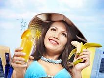 Girl in bikini drinking cocktail. Royalty Free Stock Photo