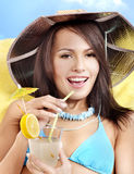 Girl in bikini drinking coctail through a straw. Stock Photo