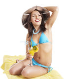 Girl in bikini drinking  juice. Royalty Free Stock Photography