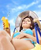 Girl in bikini drinking orange juice. Royalty Free Stock Photo
