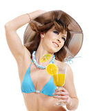 Girl in bikini drinking orange juice. Royalty Free Stock Photo
