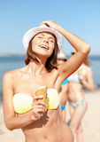 Girl in bikini eating ice cream on the beach Stock Image