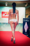 Girl in bikini in a fashion show in Trieste. Back photo. Stock Photo