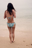 Girl in a bikini feeling cold Stock Photography