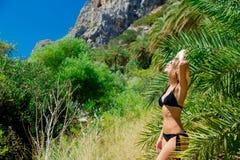 Girl in bikini and hat have rest in palm forest. Young girl in bikini and hat have rest in palm forest of Preveli, Crete, Greece stock image