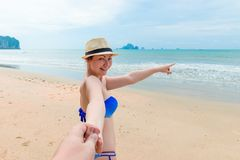 Girl in bikini and hat shows off somewhere. In the sea Royalty Free Stock Images