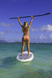 Girl in bikini on her paddle board. Beautiful girl in bikini on her stand up paddle board in Hawaii Royalty Free Stock Images
