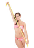 Girl in bikini holding measuring tape Royalty Free Stock Image