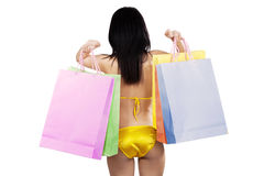 Girl in bikini holding shopping bags Royalty Free Stock Photos