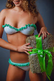 Girl in a bikini with holiday gift Royalty Free Stock Photo