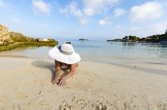 Girl in a bikini lies on the beach Stock Image