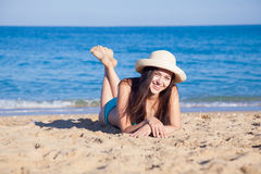 Girl in bikini lies on the beach Royalty Free Stock Photo