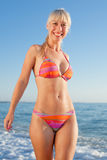 Girl in bikini looking at camera smiling Stock Photo