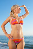 Girl in bikini looks in side Stock Image