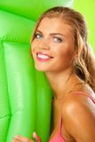 Girl in bikini with matress Royalty Free Stock Images