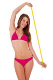 Girl in bikini with measuring tape Royalty Free Stock Photo