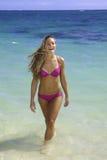 Girl in bikini in the ocean Stock Images